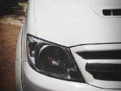 รถประมูลกลมป่าไม้แล้วนำลอดี้วีโก้มาคลอบใส่0930044550